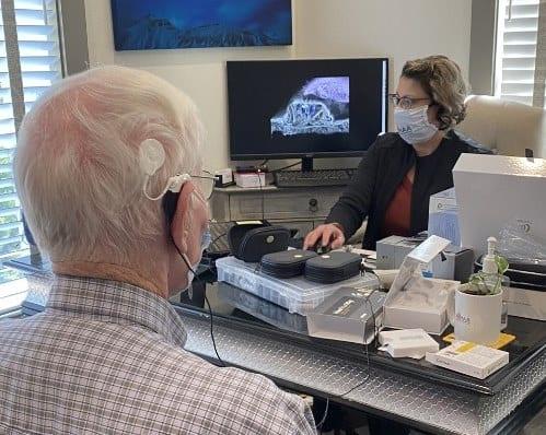 Elderly man during hearing test